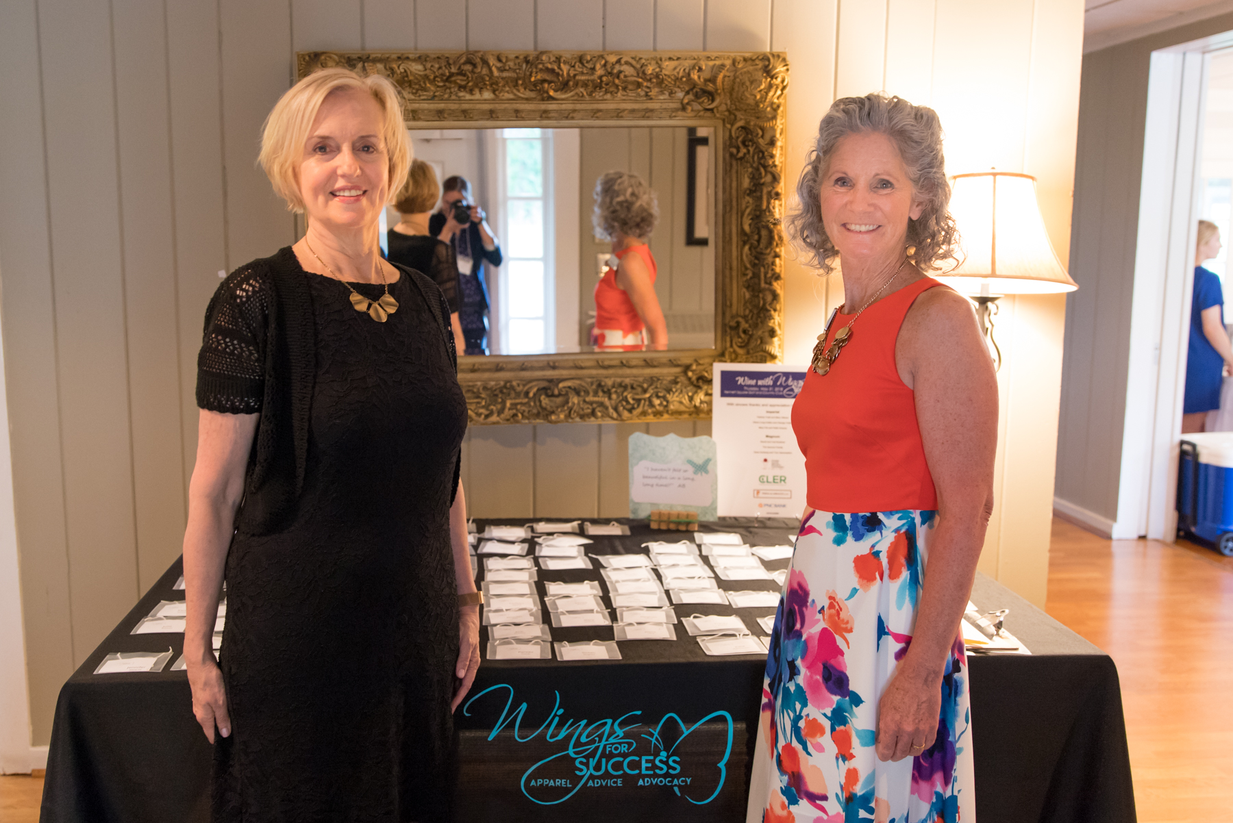 Committee Members, Vicky Will (L) and Mary Pat Knauss, host the registration table.