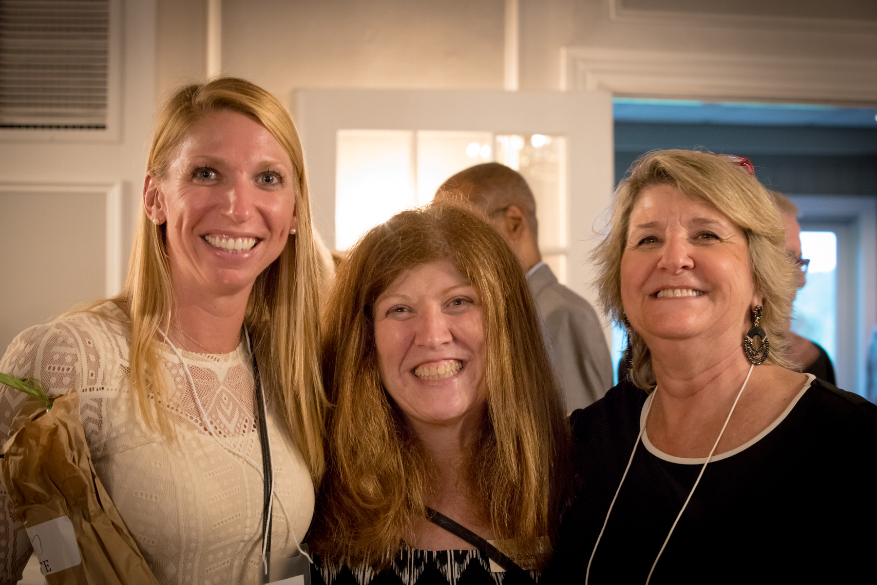Dana Dovberg, Board Treasurer (center), enjoys the evening with guests Andrea Kinnik (L) and Linda Kinnik (R).