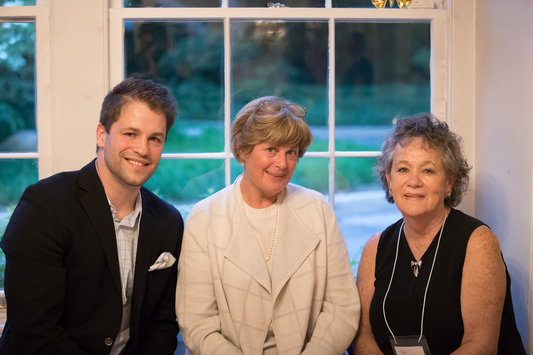 Ryan Derfler, from the Chester County Press, with Barb Goetz (center) from Wild Thyme Flowers and Janet Dadds.